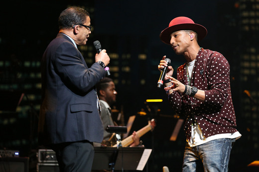 HOLLYWOOD, CA - NOVEMBER 09: Musician Herbie Hancock (L) and singer/songwriter Pharrell Williams perform onstage at the 2014 Thelonious Monk International Jazz Trumpet Competition at Dolby Theatre on November 9, 2014 in Hollywood, California. (Photo by Imeh Akpanudosen/Getty Images for Thelonious Monk Institute of Jazz)