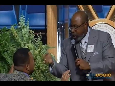 """Rev. Earl Carter congratulates attendee Andrew Caldwell after he says, """"I'm not gay no more!"""""""