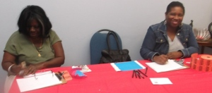 Linda Collins and Que'Ron Hildreth at Registration Table: Photo Credit, Ricky Richardson