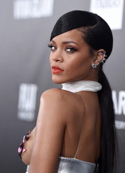 Rihanna arrives at the amfAR LA Inspiration Gala in Los Angeles, October 2014