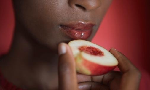 black-woman-eating-peach