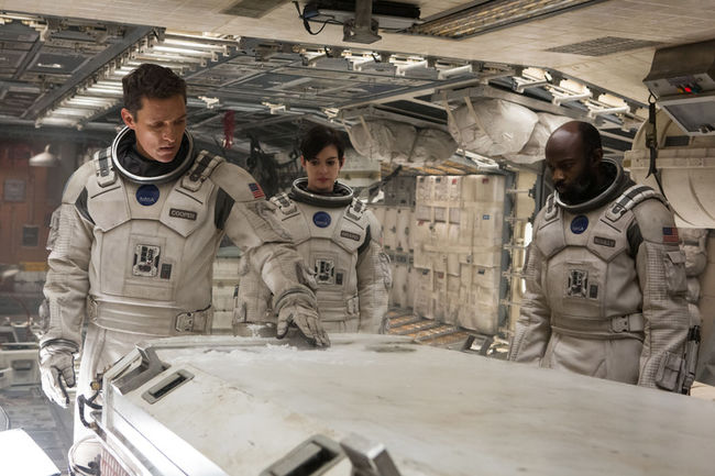 Left to right: Matthew McConaughey, Anne Hathaway, and David Gyasi in INTERSTELLAR, from Paramount Pictures and Warner Brothers Entertainment.