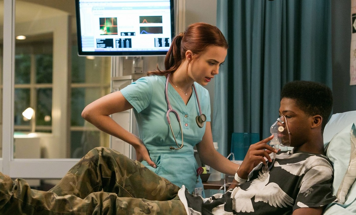 "L-R: Nurse Dobler (Rebecca Rittenhouse) and Dash (Brian Bradley) in the ""So Tell Me What You Want"" episode of RED BAND SOCIETY"