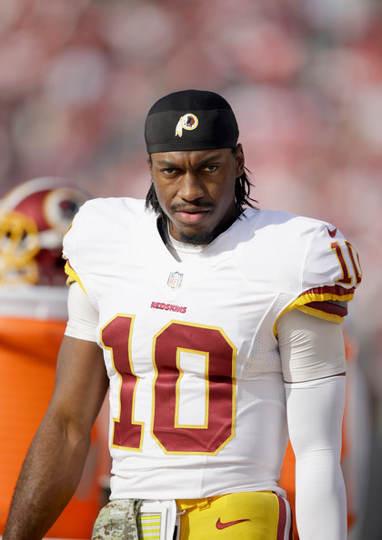Robert Griffin III #10 of the Washington Redskins stands on the sidelines before their game against the San Francisco 49ers at Levi's Stadium on November 23, 2014 in Santa Clara, California