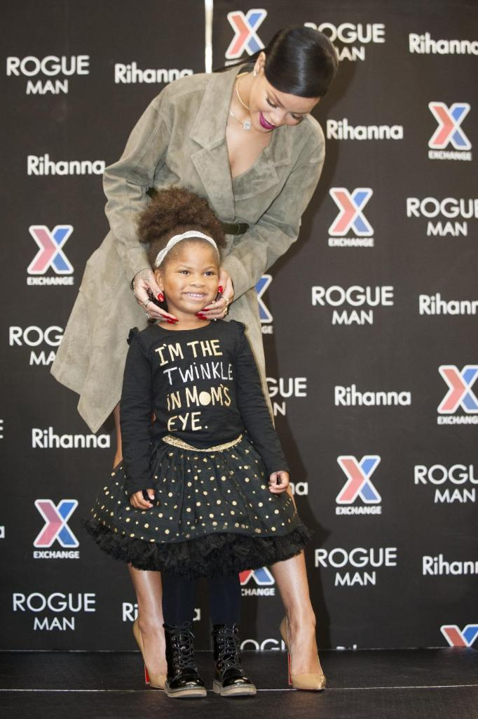 Rihanna poses for a photo with Summer Bryant during an event promoting Rogue Man at Ft. Belvoir Exchange on Wednesday, Nov. 12, 2014 in Ft. Belvoir, Va.