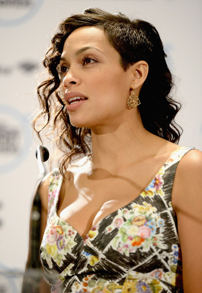 Actress Rosario Dawson, wearing Piaget Rose Dentelle earrings, speaks onstage during the 30th Film Independent Spirit Awards Nominations Press Conference at the W Hollywood on November 25, 2014 in Hollywood, California