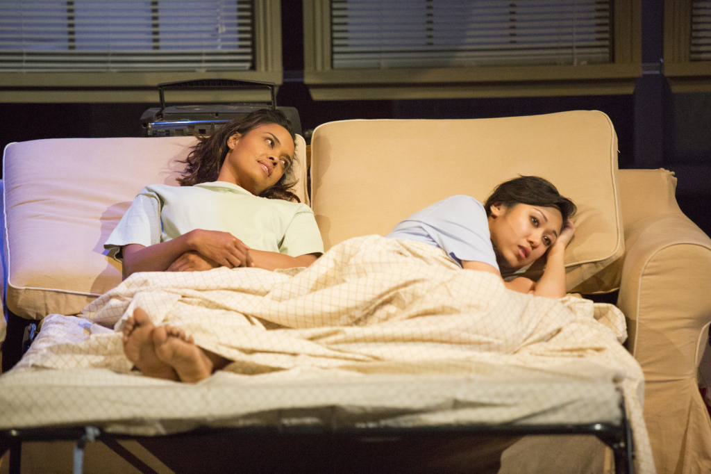 """Sharon Leal and Angela Lin. """"Maybe the cat will come from under the bed if you're here."""" Photo credit: Jim Cox"""