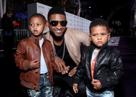 Usher with sons Usher V (L) and Nayvid Ely attend the Los Angeles premiere of 'Justin Bieber: Never Say Never' at Nokia Plaza in Los Angeles, Calif.