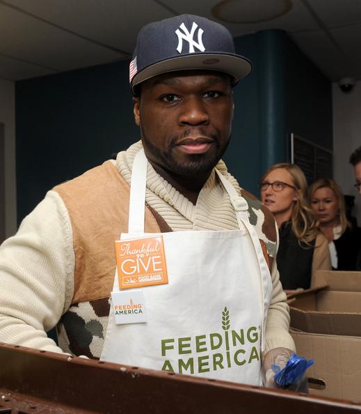50 Cent attends Feeding America Hosts Bi-Coastal Celebrity Volunteer Event at Harlem Communiy Kitchen on December 11, 2014 in New York City