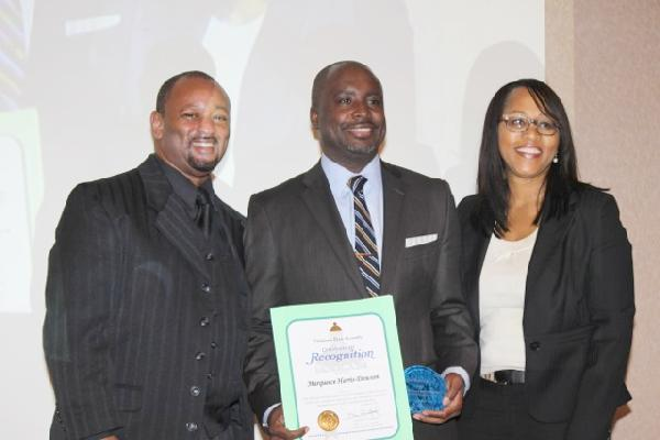 Mr. Najee Ali & Ms. Myla Rahman Presents Recognition Award To Marqueece Harris-Dawson