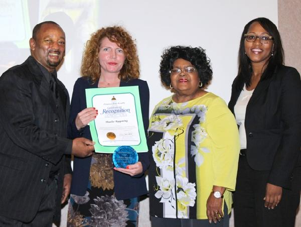 Mr. Najee Ali, Ms. Myla Rahman and Jimmy Woods Gray Presents Recognition Award to Ms. Heather Marie