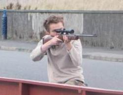 white teen aims rifle