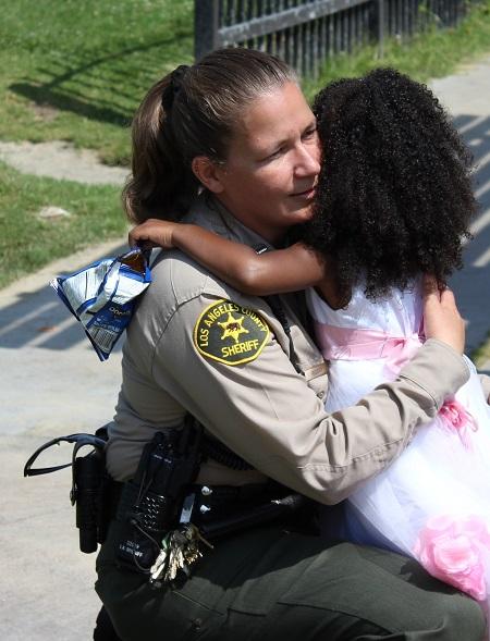 Officer hugs little girl at 'Walk for Life'