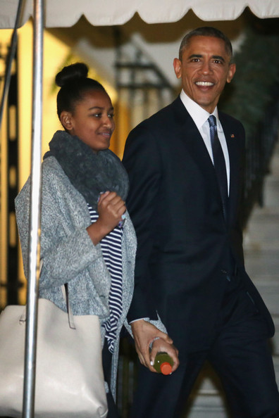 President Barack Obama and his daughter Sasha Obama leave the White House for their holiday vacation December 19, 2014 in Washington, DC.