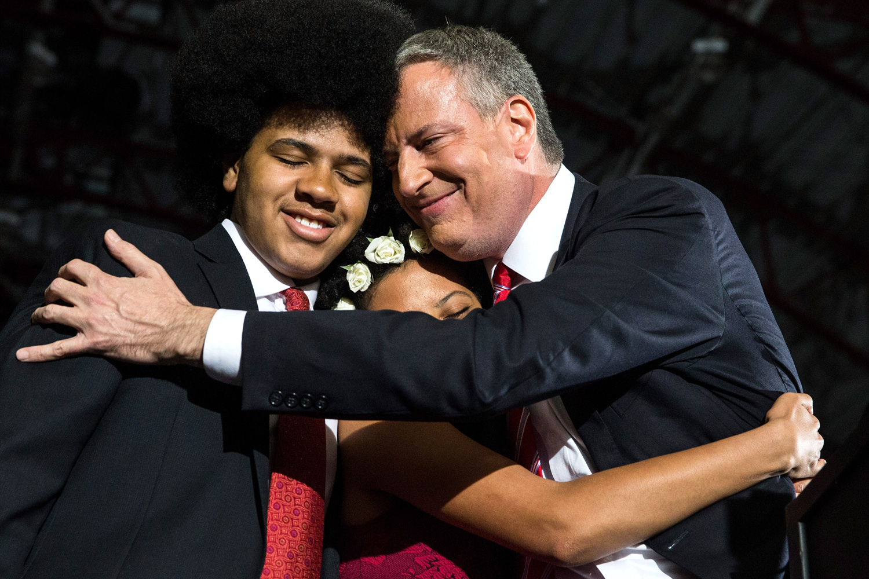 Newly elected New York City Mayor Bill de Blasio (R) hugs his son Dante de Blasio (L) and daughter Chiara de Blasio at his election night party on November 5, 2013 in New York City.