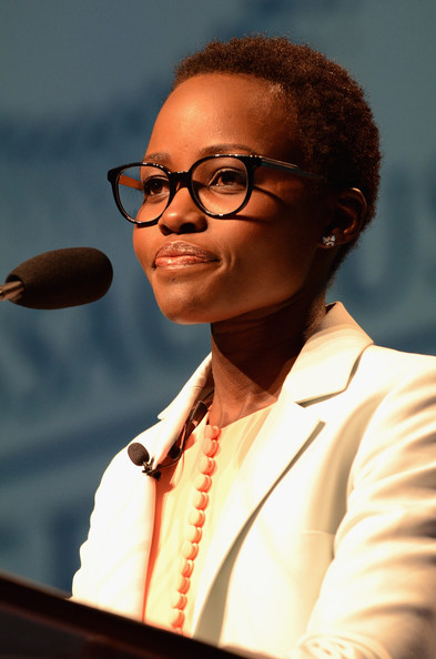 Actress Lupita Nyong'o speaks on stage at the 2014 Massachusetts Conference for Women at Boston Convention & Exhibition Center on December 4, 2014 in Boston, Massachusetts