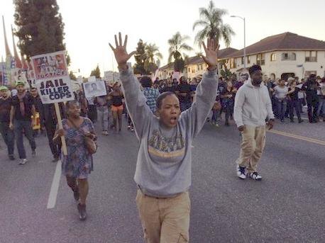 protesters in la hands up