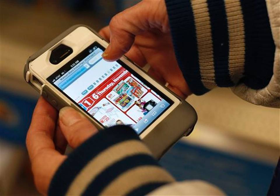 smart phone in hands with target ad