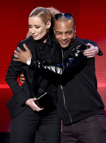 Iggy Azalea (L) and T.I. accept the Favorite Rap/Hip-Hop Album award for 'The New Classic' onstage at the 2014 American Music Awards at Nokia Theatre L.A. Live on November 23, 2014 in Los Angeles, California