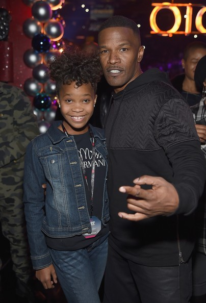 Actors Quvenzhane Wallis and Jamie Foxx pose backstage at iHeartRadio Jingle Ball 2014, hosted by Z100 New York and presented by Goldfish Puffs at Madison Square Garden on December 12, 2014 in New York City