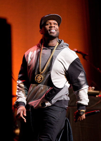 "Rapper 50 Cent performs during the 4th Annual ""Home For The Holidays"" Benefit Concert at Beacon Theatre on December 6, 2014 in New York City"