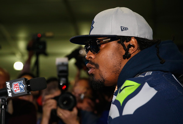 Running back Marshawn Lynch #24 of the Seattle Seahawks speaks during a Super Bowl XLIX media availability at the Arizona Grand Hotel on January 29, 2015 in Chandler, Arizona