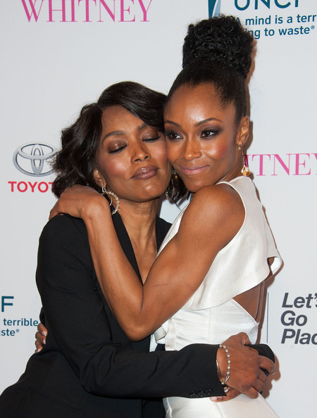 """Director/actress Angela Bassett (L) and actress Yaya DaCosta arrive at the Premiere Of Lifetime's """"Whitney"""" at The Paley Center for Media on January 6, 2015 in Beverly Hills, California"""