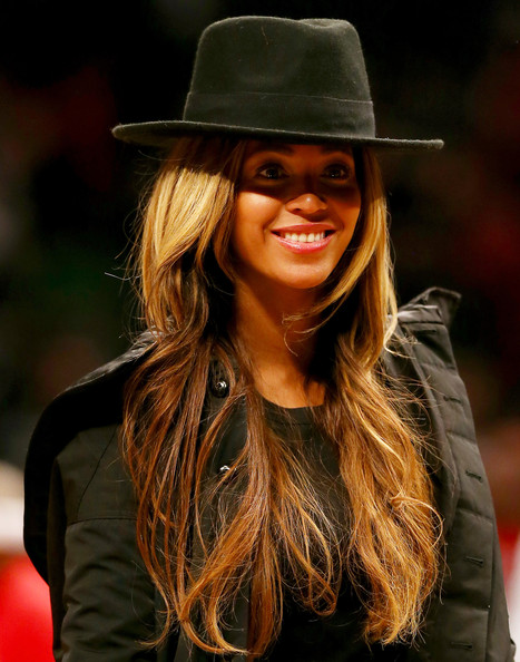 Beyonce walks off the court after the game between the Brooklyn Nets and the Houston Rockets at the Barclays Center on January 12, 2015 in the Brooklyn borough of New York City.