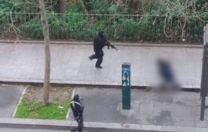 The video still image shows the blurred-out image of a kneeling Paris police officer being shot by the fleeing gunmen