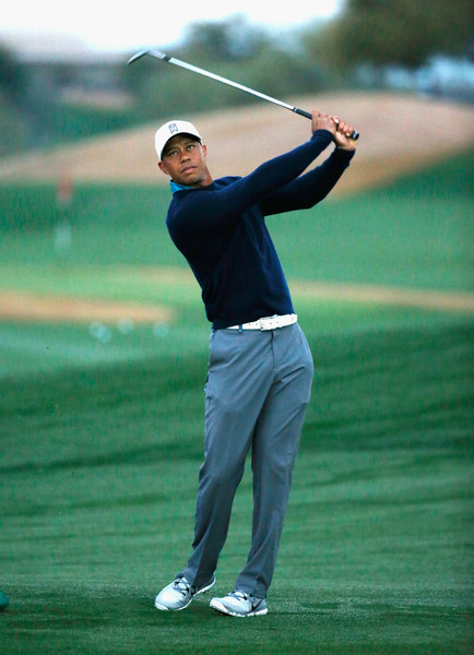 Tiger Woods hits a shot on the practice ground before a practice round prior to the start of the Waste Management Phoenix Open at TPC Scottsdale on January 27, 2015 in Scottsdale, Arizona