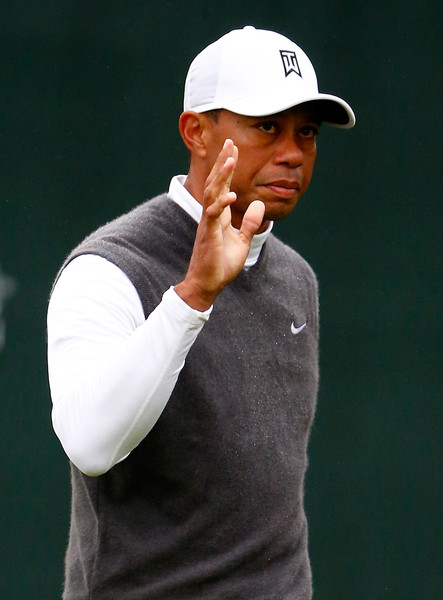 Tiger Woods acknowledges the gallery on the 16th green during the second round of the Waste Management Phoenix Open at TPC Scottsdale on January 30, 2015 in Scottsdale, Arizona.