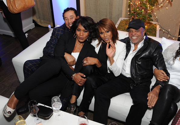 """Singer Smokey Robinson, director Angela Bassett, singer Deborah Cox and record producer Berry Gordy attend the premiere after party of Lifetime's """"Whitney"""" at Spago on January 6, 2015 in Beverly Hills, California"""