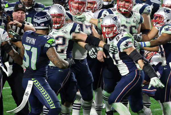 Bruce Irvin #51 of the Seattle Seahawks and Rob Gronkowski #87 of the New England Patriots exchange words late in the fourth quarter during Super Bowl XLIX at University of Phoenix Stadium on February 1, 2015 in Glendale, Arizona.