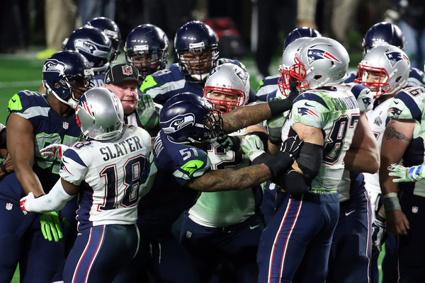 Bruce Irvin #51 of the Seattle Seahawks and Rob Gronkowski #87 of the New England Patriots exchange words after a play late in the game during Super Bowl XLIX at University of Phoenix Stadium on February 1, 2015 in Glendale, Arizona