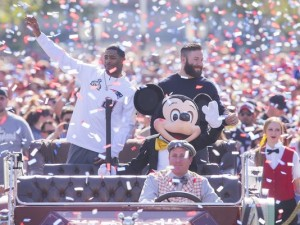 New England Patriots players Julian Edelman (right) and Malcolm Butler were joined by Mickey Mouse as they celebrated their team's Super Bowl XLIX championship victory with a special cavalcade down Main Street, U.S.A. at Disneyalnd park in Anaheim, Calif., on Monday.