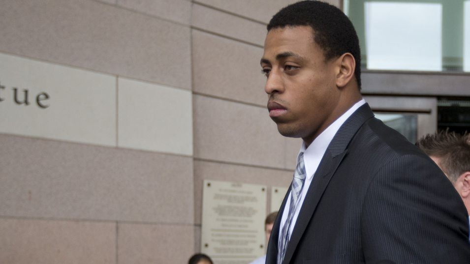 Greg Hardy leaves a Charlotte, NC courthouse Monday, Feb. 9, 2015, after the domestic violence case against him fell apart