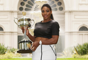 Serena Williams of the United States holds the Daphne Akhurst Memorial Cup during a photocall at the Royal Exhibition Building in Carlton Gardens after winning the 2015 Australian Open on February 1, 2015 in Melbourne, Australia