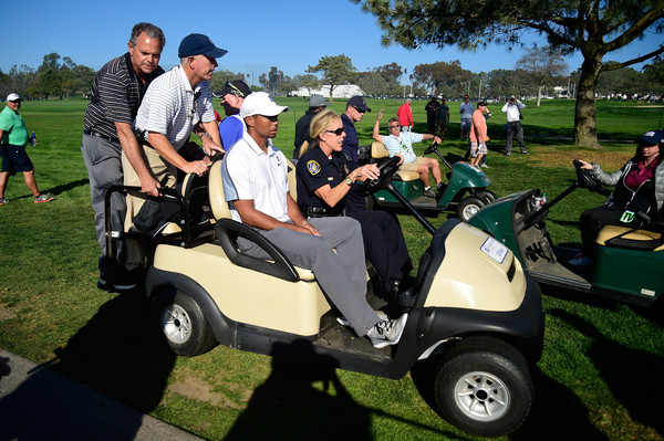 Tiger Woods leaves the course after withdrawing from the Farmers Insurance Open due to injury at Torrey Pines Golf Course on February 5, 2015 in La Jolla, California