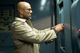 Common, as the terrifying Price, tampering with the lights in Run All Night.