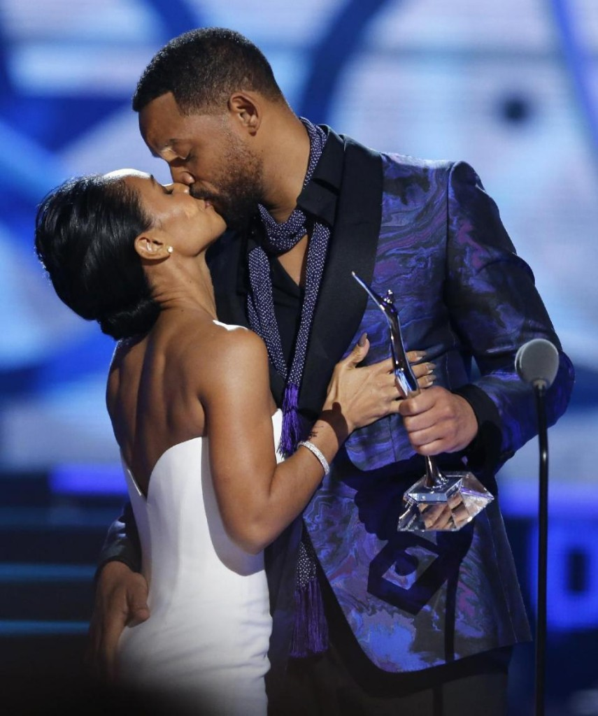 Will Smith, right, gives a hug to his wife Jada Pinkett Smith before Will Smith gave Pinkett Smith the Star Power award  during a taping of the Black Girls Rock award ceremony at the New Jersey Performing Arts Center, Saturday, March 28, 2015, in Newark, N.J.