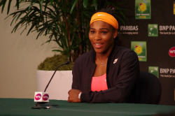 An upbeat Serena Williams addresses the press after withdrawal. Photo credit: Anita Stahl