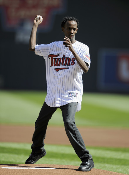 Actor Barkhad Abdi delivers a ceremonial pitch before the home opening game between the Minnesota Twins and the Oakland Athletics on April 7, 2013 at Target Field in Minneapolis, Minnesota