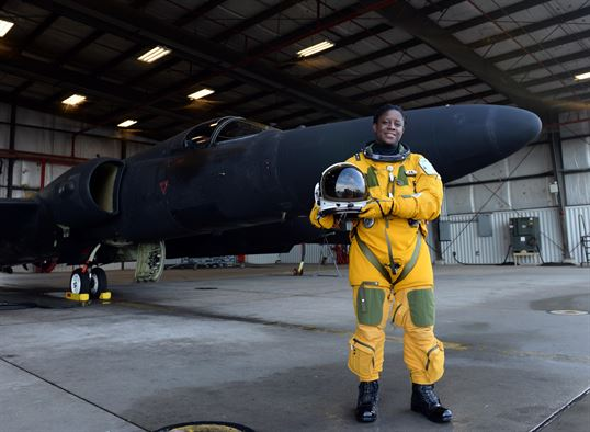 Lt. Col. Merryl Tengesdal stands in front of a U-2 Feb. 9, 2015, at Beale Air Force Base, Calif. Tengesdal is the only black female U-2 pilot in history. Tengesdal is the 9th Reconnaissance Wing inspector general and a U-2 pilot.