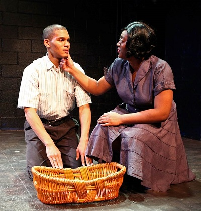 James Ross (Emmett) being warned by his mother, Mamie (Jasmine Saunise) about the segregated South.