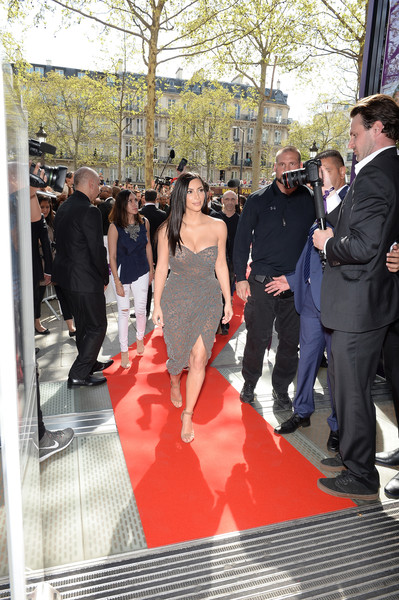 Kim Kardashian arrives to introduce her 'Kardashian Beauty Hair' line at Marionnaud Champs Elysees on April 15, 2015 in Paris, France