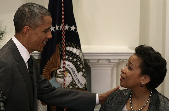 U.S. President Barack Obama (L) introduce Loretta Lynch (R) as his nominee to replace Eric Holder as Attorney General during a ceremony in the Roosevelt Room of the White House November 8, 2014 in Washington, DC.
