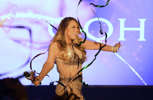 """Mariah Carey dances as streamers fall to the ground as she arrives at The Colosseum at Caesars Palace to launch her residency """"MARIAH #1 TO INFINITY"""" on April 27, 2015 in Las Vegas, Nevada."""