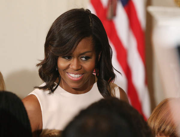 First lady Michelle Obama attends a poetry reading the State Dining Room at the White House April 17, 2015 in Washington, DC. The first lady hosted the event in celebration of National Poetry Month