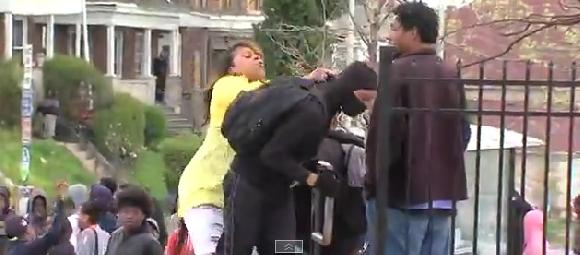 mother smacks son at baltimore riot