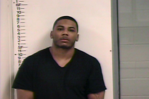 In this handout photo provided by the Putnam County Sheriff's Department, singer Nelly, born Cornell Haynes, Jr., is seen in a police booking photo after his arrest for felony possession of drugs, possession of marijuana and drug paraphernalia April 10, 2015 in Patnam Country, Tennessee